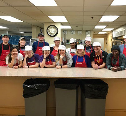 Curry College Honors students and faculty volunteer to prepare and serve meals at Rosie's Place, a Boston shelter for homeless women