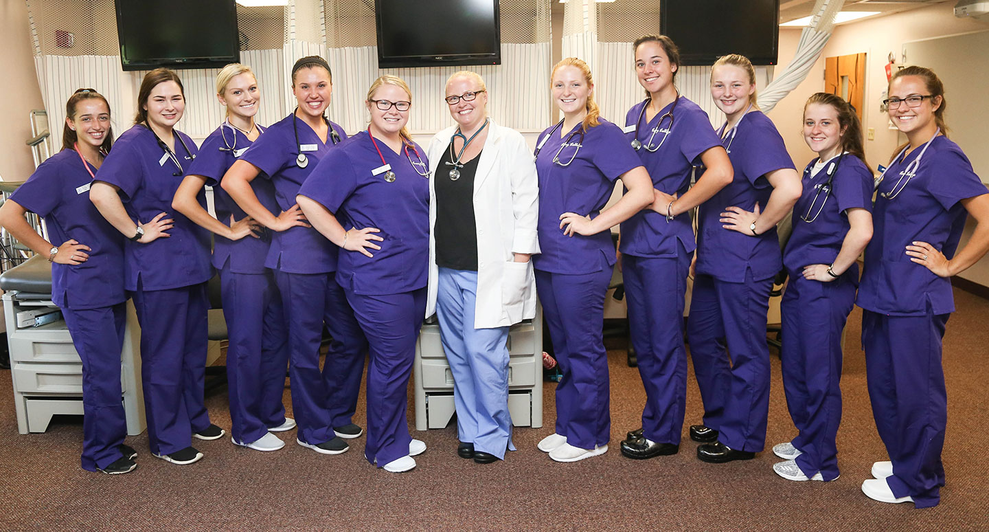 Curry College School of Nursing students in their Purple Scrubs