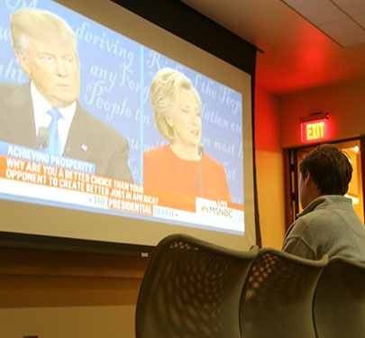 Curry College Politics and History Club members watch the 2016 Presidential Debate