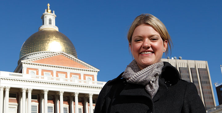Student standing outside the Massachusetts State House, repesenting the Politics anbd History Degree at Curry College