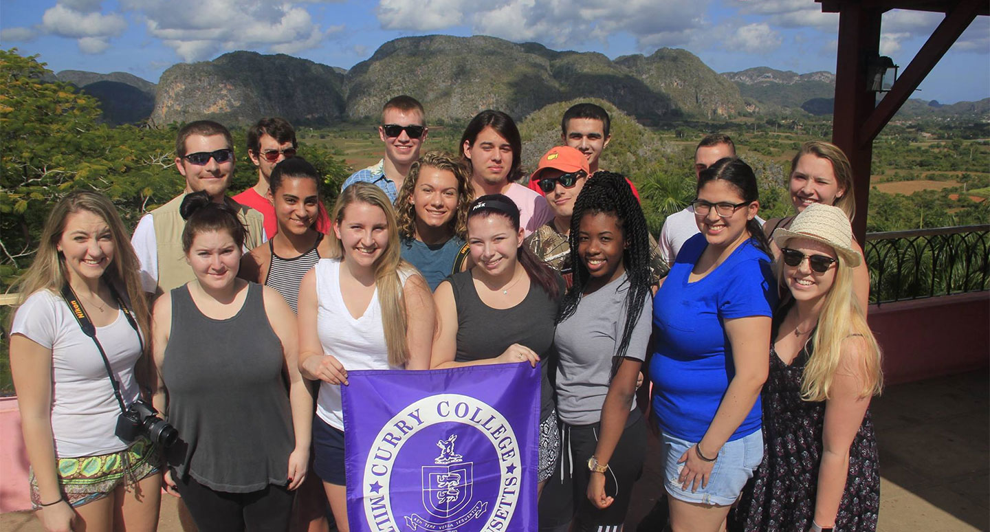 Curry College students pose for a photo in Cuba during a Study Abroad faculty led trip