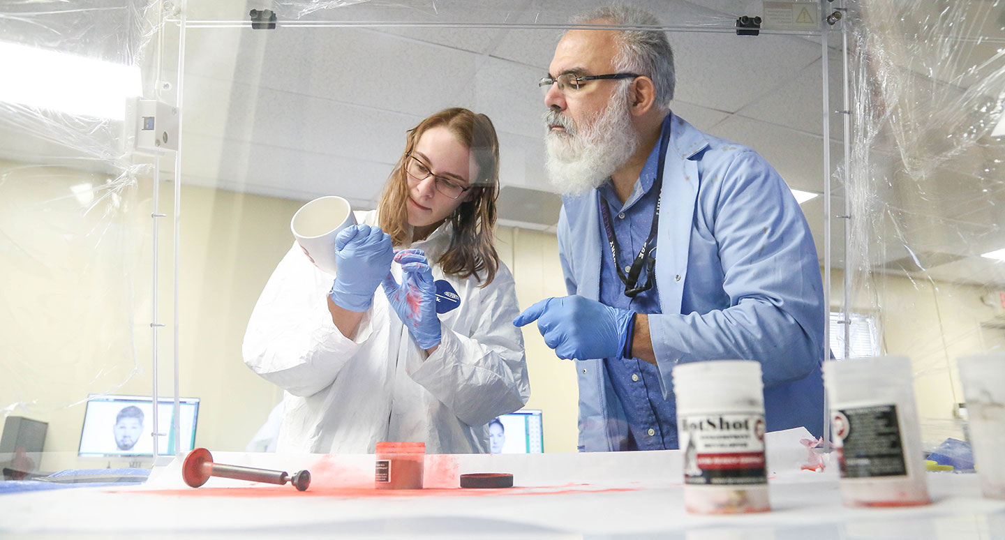 A student and faculty member Collaborate in the Curry College Forensic Science Lab