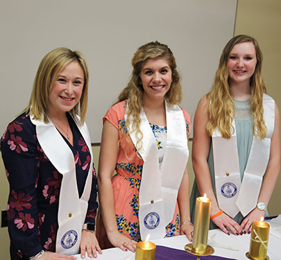 Curry College students receive their Education Honor Society certificate