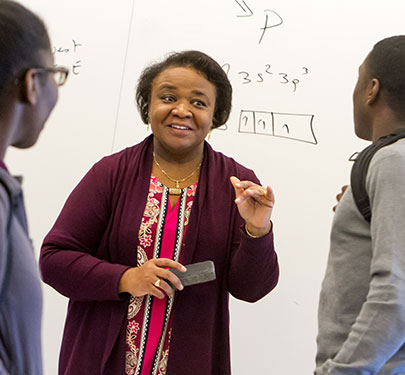 A Curry College faculty member interacts with students in the classroom