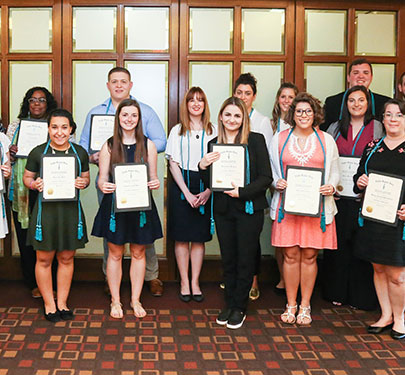 Curry College students receive their Sociology Honor Society certificate
