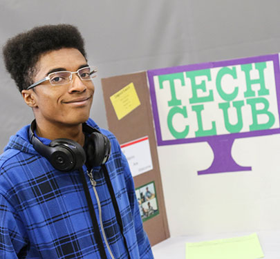 A Curry College Tech Club student at an involvement fair
