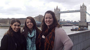 Curry College Students Studying abroad in London, pose in front of London Bridge