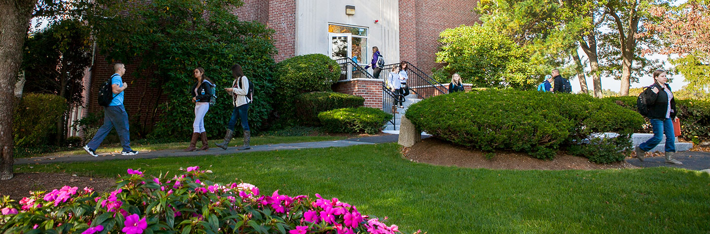 Students walking on campus at Curry College representing Explore Curry Days