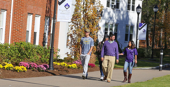 A Curry College Student Admission tour guide gives a tour to a family