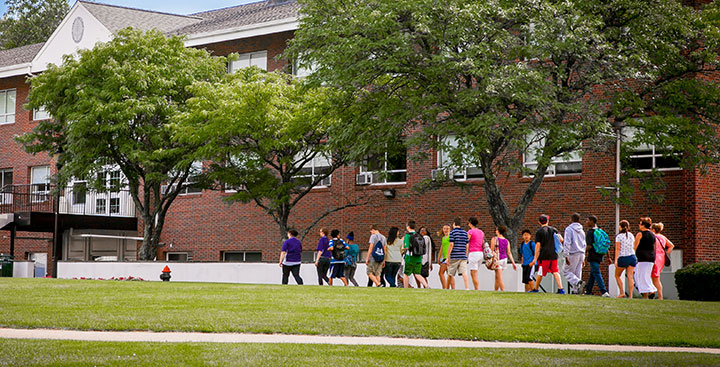 Students and parents take a tour of the Curry College campus