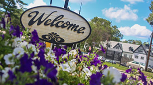 Curry College Welcome sign at the front gate