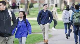 Students walking on campus at Curry College