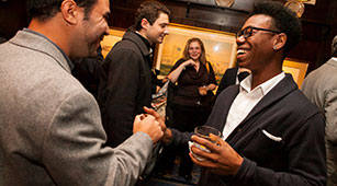 Alumni meet up at the 21 Club in Manhattan for the annual Curry College New York City Reception for alumni, parents, and friends