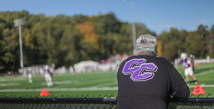 A Curry Alumnus watches a Colonels Athletics football game
