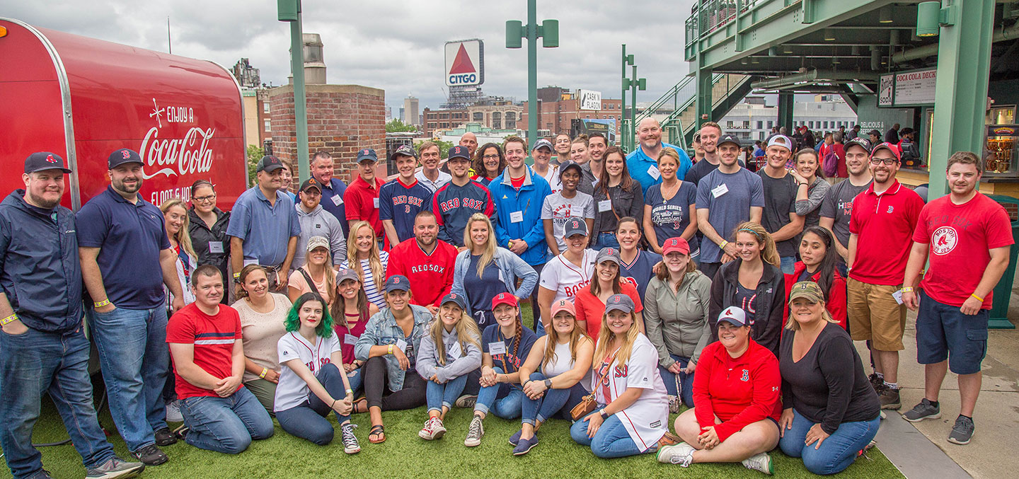 Curry College Alumni events are represented by a group photo of a recent reunion at a Red Sox game at Fenway Park