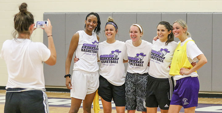 Women's Basketball players pose for a photo at the Alumni Reunion Game