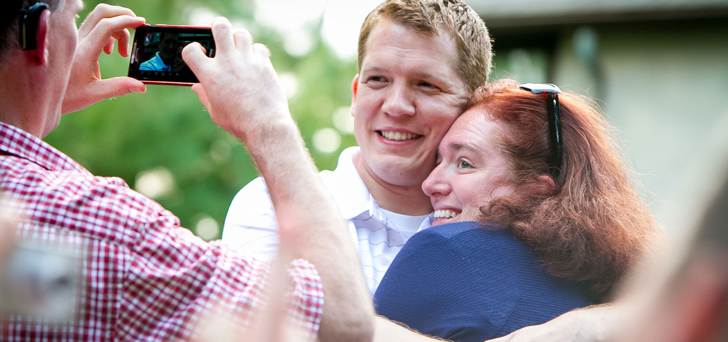Curry College Alumni hug for a photo at a recent Class Reunion