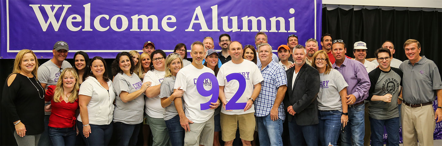 Our Class Notes page is represented by Curry College Alumni, Class of '92 posing for a photo at a recent Class Reunion