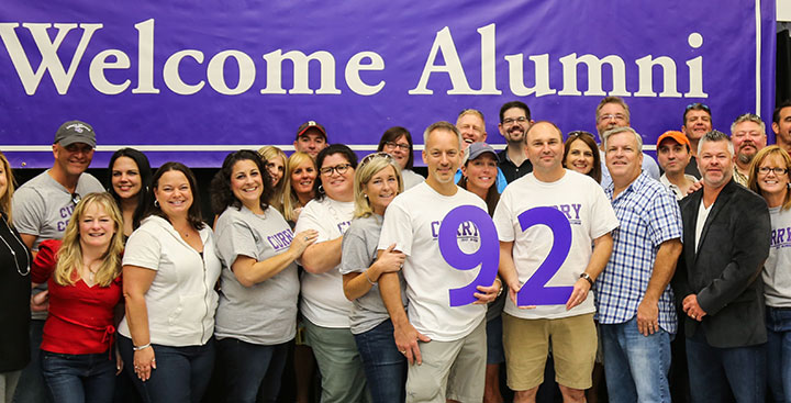 The Curry College Class of '92 poses for a photo at Homecoming