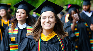 A student walks at Commencement