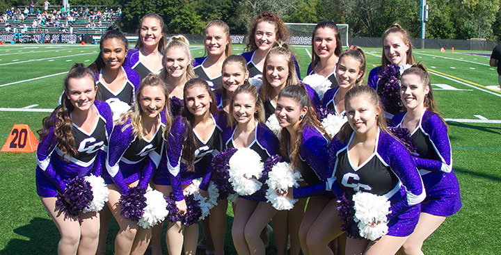 The Curry College Dance Team at a Football Game