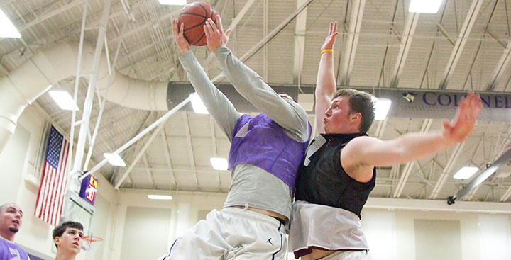 Curry College Intramural bbasketball players compete at the hoop