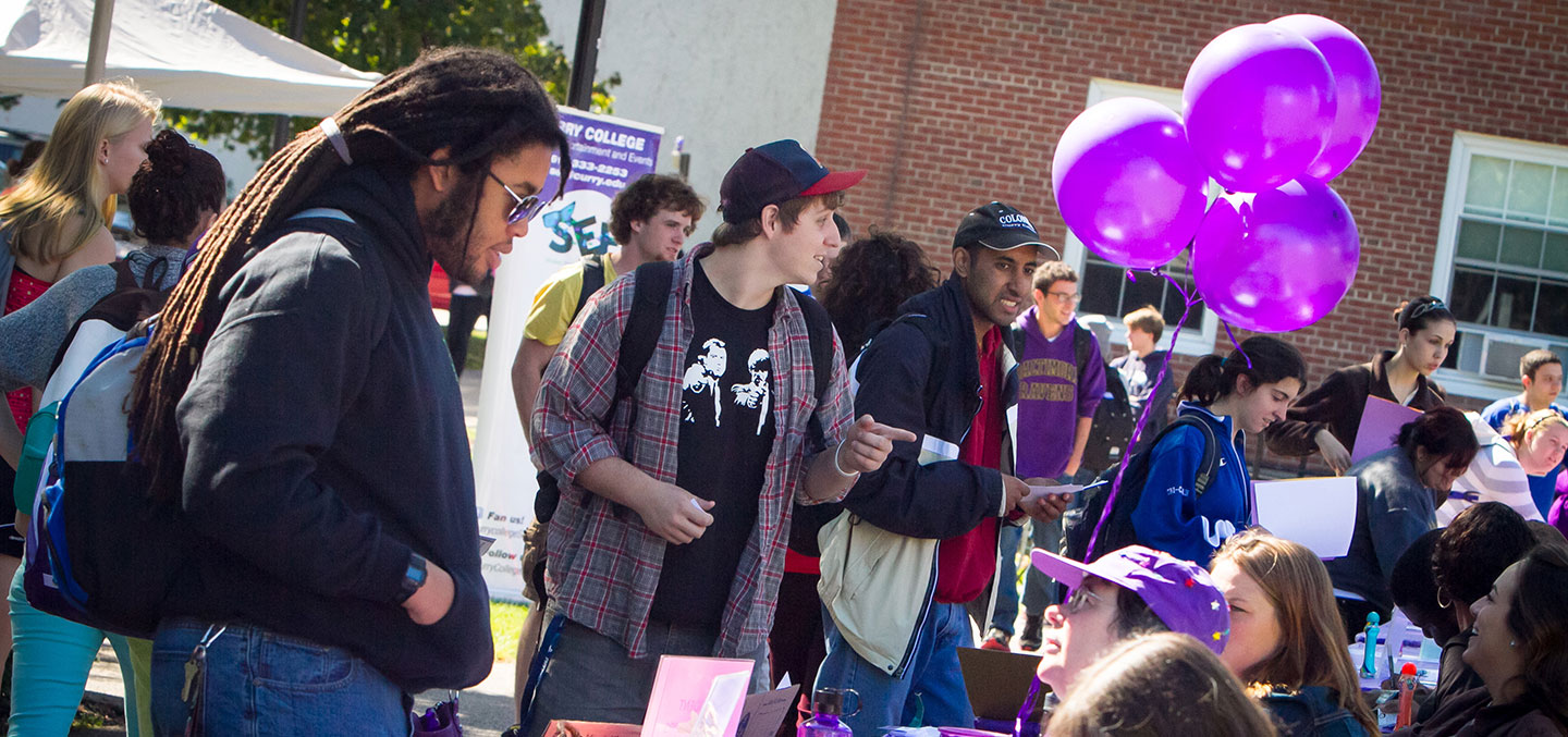 Curry students flock to different club tables at the Involvement Fair