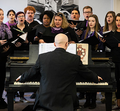 Members of the choral group SING! perform on campus