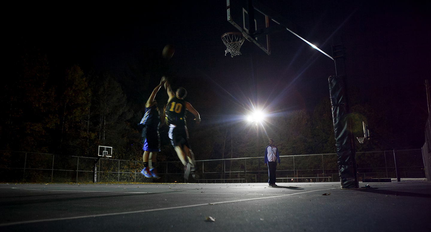 Outdoor basketball courts at night