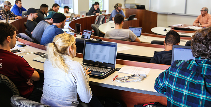 Students attending class in a lecture hall on campus