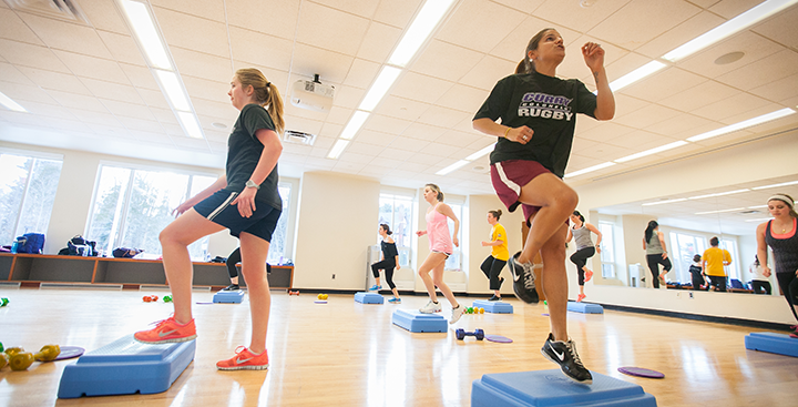 Students exercising during a fitness class in the Fitness Center