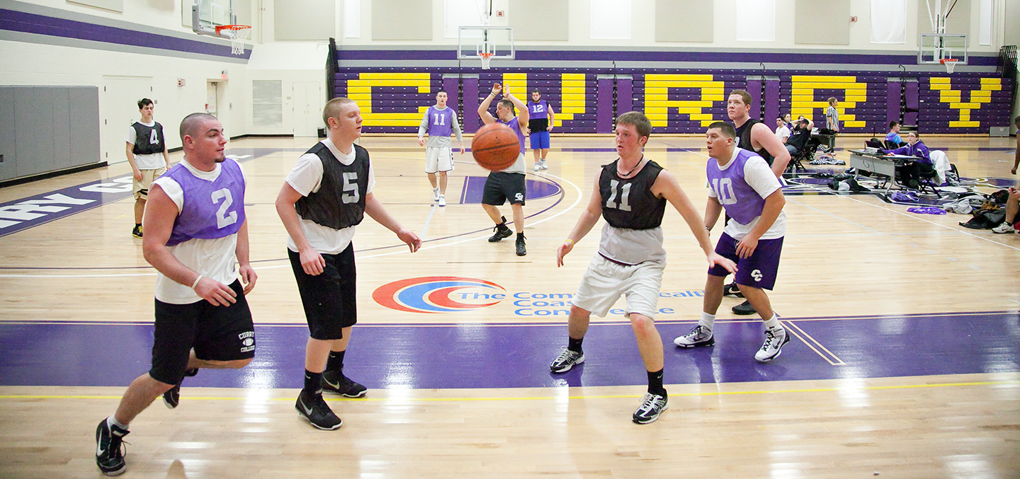 Students play basketball in the Katz Gymnasium