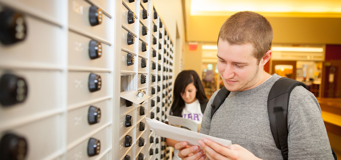 A student gets his mail at the Student Center