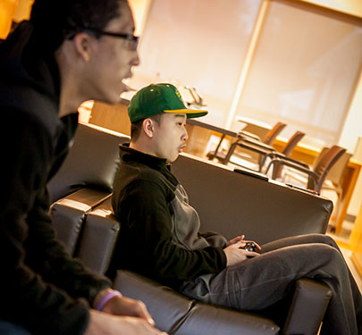 Two students playing a video game