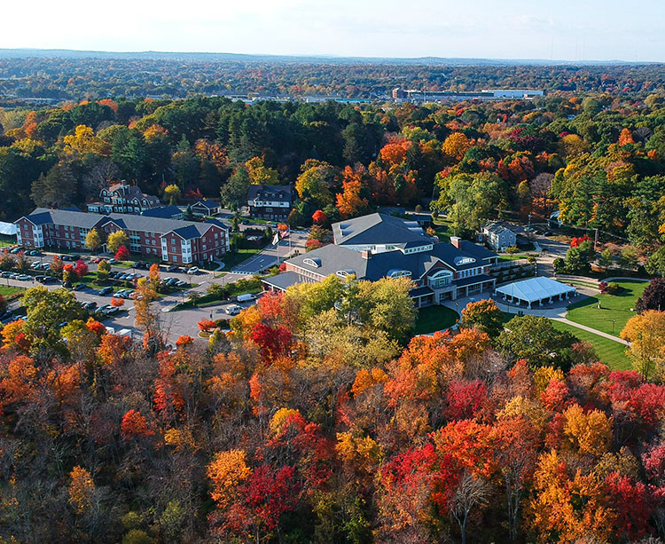 The Curry College campus is shown from above in autumn