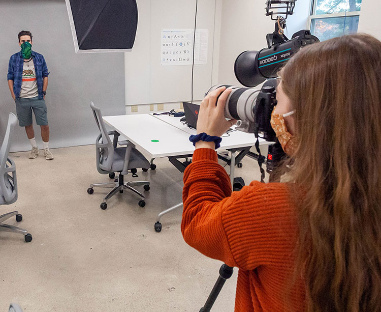 Photography Students conduct a photo shoot in the new Curry College ThinkTank design studio